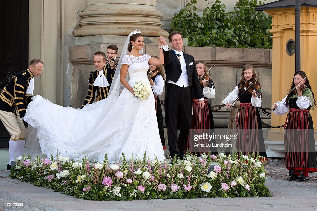 Princess Madeleine of Sweden and Christopher O'Neill greet the public after their wedding ceremony hosted by King Carl Gustaf XIV and Queen Silvia at The Royal Palace on June 8, 2013 in Stockholm, Sweden.