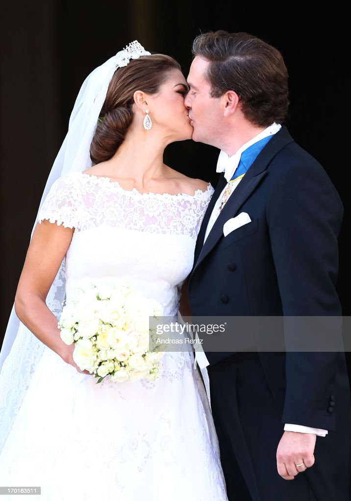 Princess Madeleine of Sweden and Christopher O'Neill kisse after the wedding ceremony of Princess Madeleine of Sweden and Christopher O'Neill hosted by King Carl Gustaf XIV and Queen Silvia at The Royal Palace on June 8, 2013 in Stockholm, Sweden.
