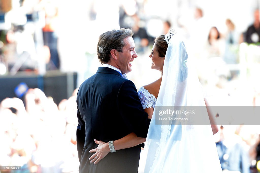 Princess Madeleine of Sweden and <a gi-track='captionPersonalityLinkClicked' href=/galleries/search?phrase=Christopher+O%27Neill&family=editorial&specificpeople=7470611 ng-click='$event.stopPropagation()'>Christopher O'Neill</a> laugh after their wedding hosted by King Carl Gustaf and Queen Silvia at The Royal Palace on June 8, 2013 in Stockholm, Sweden.