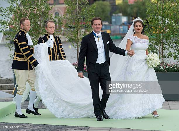 Princess Madeleine of Sweden and Christopher O'Neill leave for the banquet at Drottningholm Palace after their wedding hosted by King Carl Gustaf and...