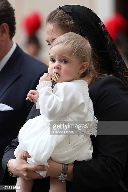 Princess Madeleine of Sweden and her daughter Princess Leonore who plays with the gift given to them by Pope Francis leave the San Damaso Courtyard...