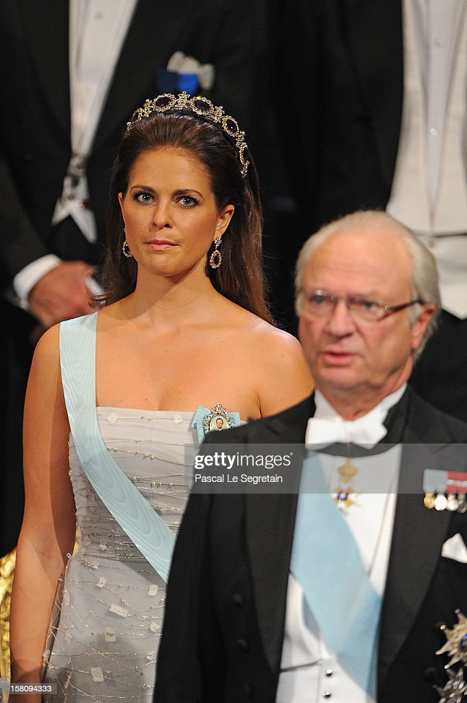 Princess Madeleine of Sweden (L) and King <a gi-track='captionPersonalityLinkClicked' href=/galleries/search?phrase=Carl+XVI+Gustaf&family=editorial&specificpeople=159449 ng-click='$event.stopPropagation()'>Carl XVI Gustaf</a> of Sweden attends the 2012 Nobel Prize Award Ceremony at Concert Hall on December 10, 2012 in Stockholm, Sweden.