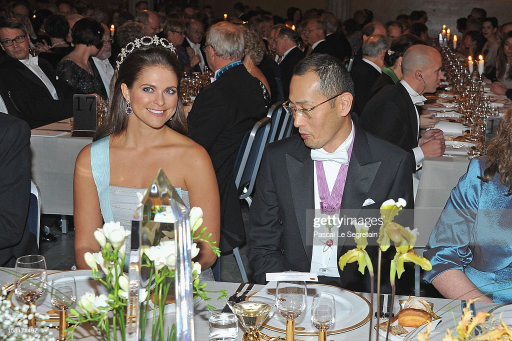 Princess Madeleine of Sweden (L) and Nobel Prize in Medicine laureate Professor Shinya Yamanaka of Japan attend the Nobel Banquet at Town Hall on December 10, 2012 in Stockholm, Sweden.