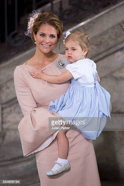 Princess Madeleine of Sweden and Princess Leonore of Sweden attend the christening of Prince Oscar of Sweden at the Royal Palace of Stockholm on May...