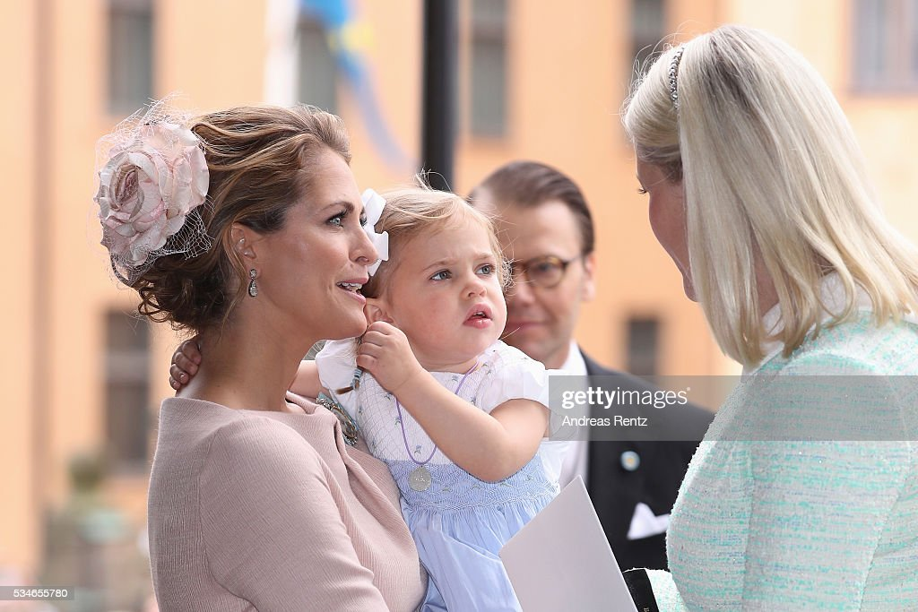 Princess Madeleine of Sweden and Princess Leonore of Sweden chat with Crown Princess Mette-Marit of Norway (R) after the christening of Prince Oscar of Sweden at Royal Palace of Stockholm on May 27, 2016 in Stockholm, Sweden.