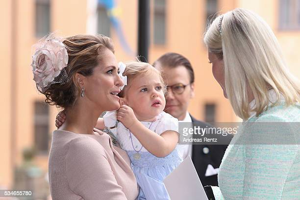Princess Madeleine of Sweden and Princess Leonore of Sweden chat with Crown Princess MetteMarit of Norway after the christening of Prince Oscar of...