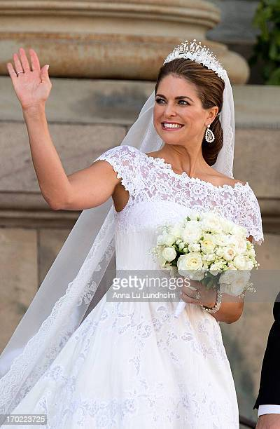 Princess Madeleine of Sweden greet the public after their wedding ceremony hosted by King Carl Gustaf XIV and Queen Silvia at The Royal Palace on...
