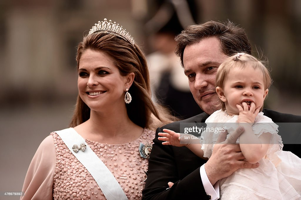 Princess Madeleine of Sweden, her husband Christopher O'Neill and their daughter Princess Leonore attend the royal wedding of Prince Carl Philip of Sweden and Sofia Hellqvist at The Royal Palace on June 13, 2015 in Stockholm, Sweden.
