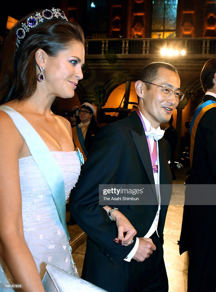Princess Madeleine of Sweden is escorted by Nobel Prize in Medicine laureate Shinya Yamanaka to the Nobel Banquet at Town Hall on December 10, 2012 in Stockholm, Sweden.
