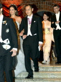 Princess Madeleine of Sweden is escorted by Nobel Prize in Medicine laureate Shinya Yamanaka while his wife Chika Yamanaka is escorted by Nobel Prize...