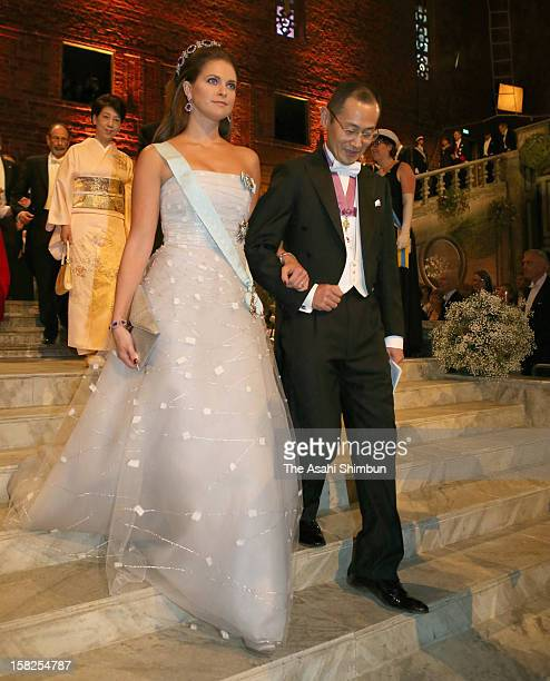 Princess Madeleine of Sweden is escorted by Nobel Prize in Medicine laureate Shinya Yamanaka to the Nobel Banquet at Town Hall on December 10 2012 in...
