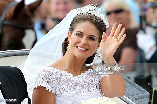 Princess Madeleine of Sweden is taken by horse and carriage from the Royal Palace of Stockholm to Riddarholmen after the wedding of Princess...