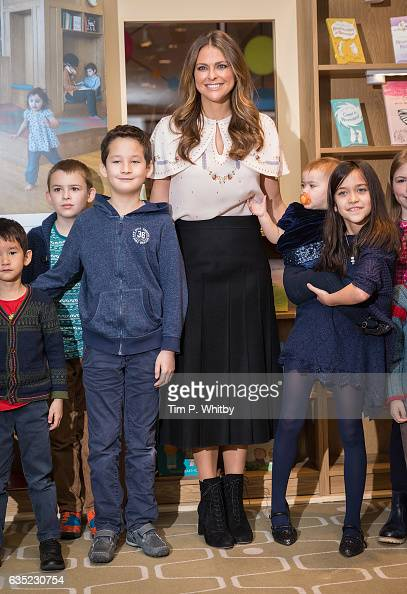 Princess Madeleine of Sweden poses for a photo with children during a visit to the Southbank Centre's 'Imagine' Children's festival where she opened...