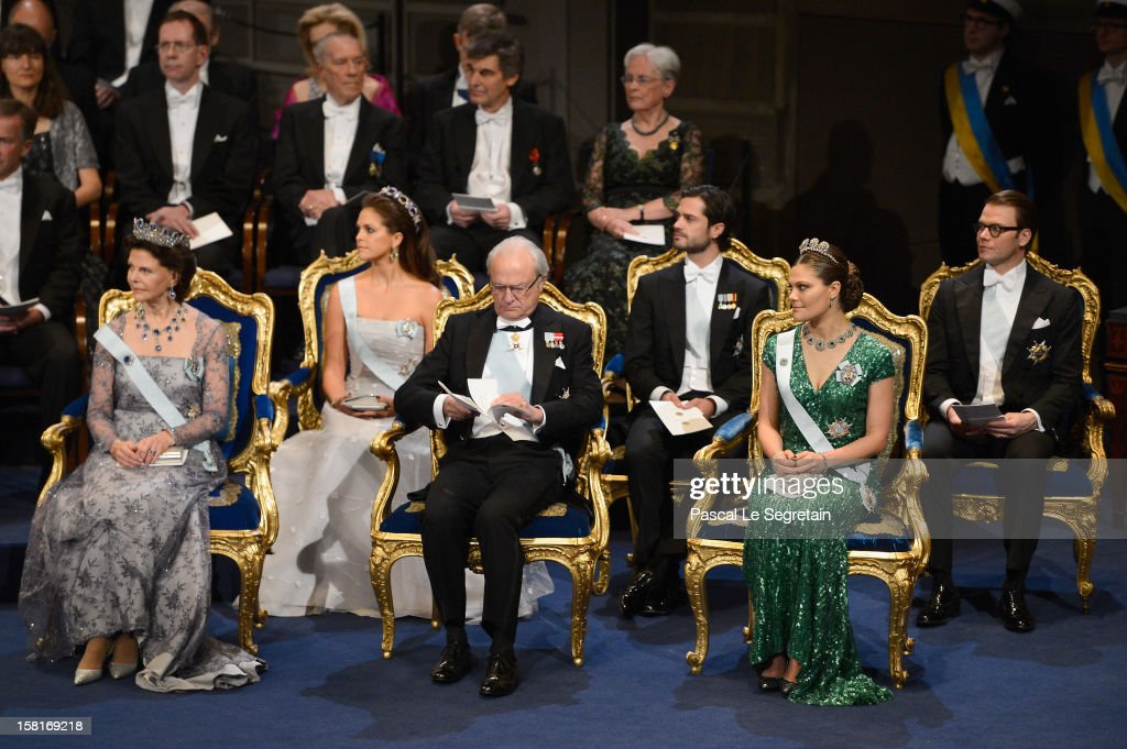 Princess Madeleine of Sweden, Prince Carl Philip of Sweden and Prince Daniel of Sweden and (Front row, L-R) Queen Silvia of Sweden, King Carl XVI Gustaf of Sweden and Crown Princess Victoria of Sweden attend the Nobel Prize Ceremony at Concert Hall on December 10, 2012 in Stockholm, Sweden.