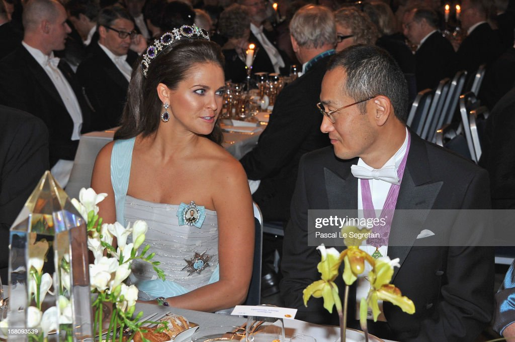 Princess Madeleine of Sweden (L) speaks with laureate and Nobel Prize winner for Medicine, Professor <a gi-track='captionPersonalityLinkClicked' href=/galleries/search?phrase=Shinya+Yamanaka&family=editorial&specificpeople=4810477 ng-click='$event.stopPropagation()'>Shinya Yamanaka</a> of Japan during the Nobel Banquet after the 2012 Nobel Peace Prize Ceremony at Town Hall on December 10, 2012 in Stockholm, Sweden.