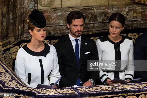 Princess Madeleine Prince Carl Philip and Princess Sofia of Sweden attend a service at the Church of St Nicholas in connection with the opening of...