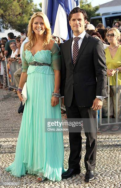 Princess Madeline of Sweden and Prince Carl Philip arrive for the wedding of Prince Nikolaos and Miss Tatiana Blatnik at the Cathedral of Ayios...