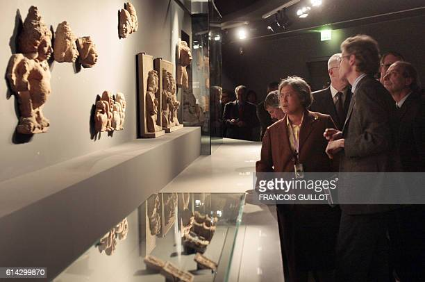 Princess Maha Chakri Sirindhorn from Thailand daughter of Thai King Bhumibol Adulayadej looks at sculptures as she visits in Paris on March 19 the...