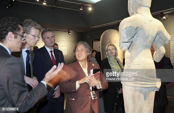 Princess Maha Chakri Sirindhorn from Thailand daughter of Thai King Bhumibol Adulayadej listens to explanations as she visits in Paris on March 19...