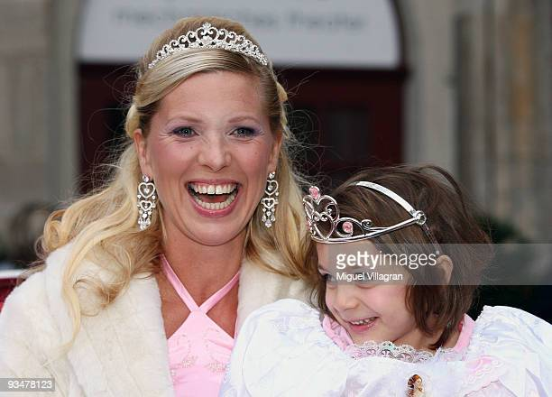 Princess Maja von Hohenzollern sits in a carriage wih a child and poses during the premiere of the Disney film 'Kiss the frog' on November 29 2009 in...