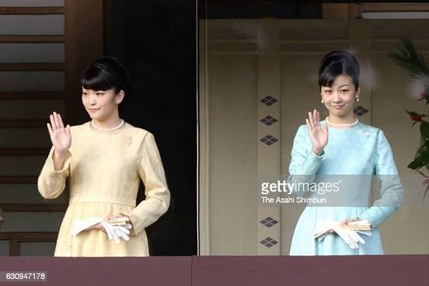 Princess Mako and Princess Kako wave to wellwishers during a New year Greeting session at the Imperial Palace on January 2 2017 in Tokyo Japan