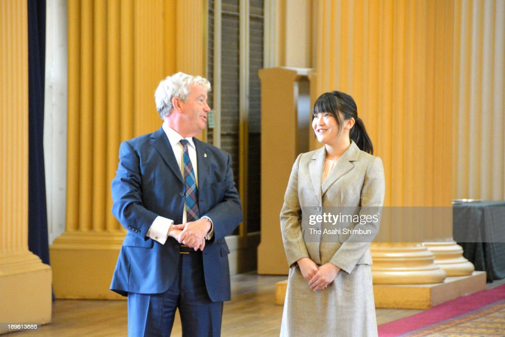 Princess Mako of Akishino (R) and Principal of the University of Edinburgh Sir Timothy O'Shea talk at the campus library on May 27, 2013 in Edinburgh, Scotland. Princess Mako completes the foreign exchange program.