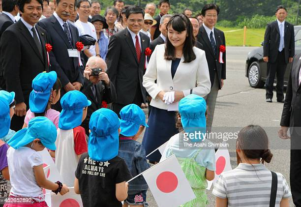 Princess Mako of Akishino is welcomed by local kindergarten pupils on arrival on July 24 2014 in Gotenba Shizuoka Japan