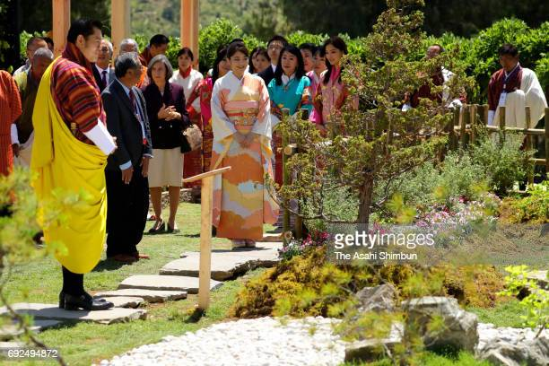 Princess Mako of Akishino King Jigme Khesar Namgyel Wangchuck and Queen Jetsun Pema watch a Japanese garden during their visit a flower exhibition on...