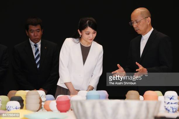Princess Mako of Akishino listens to explanation during her visit to the International Ceramics Festival on September 14 2017 in Tajimi Gifu Japan