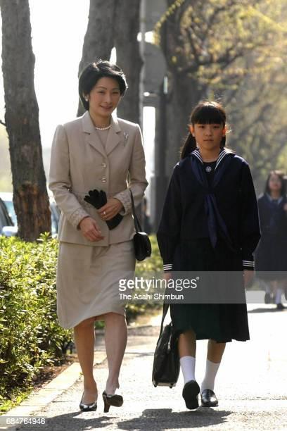 Princess Mako of Akishino walks along with her mother Princess Kiko prior to the welcome ceremony of the Gakushuin Girls' Junior High School on April...