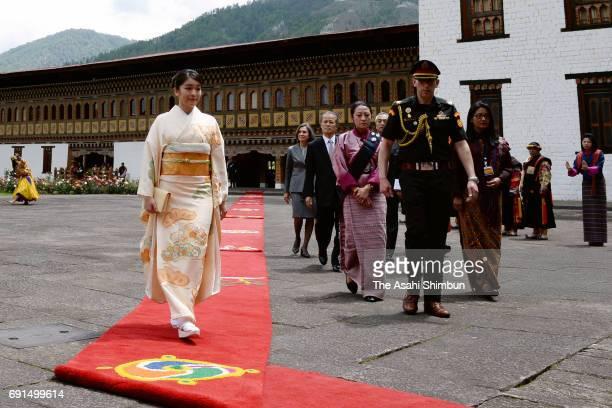 Princess Mako of Akishino walks to the office of King Jigme Khesar Namgyel Wangchuck of Bhutan prior to their meeting at Tashichho Dzong on June 2...