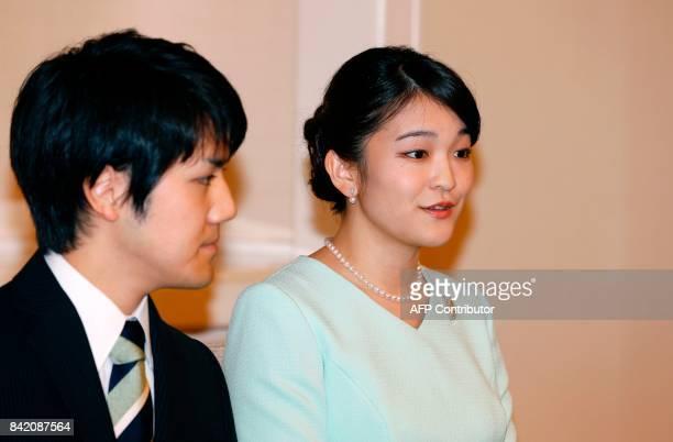 Princess Mako the eldest daughter of Prince Akishino and Princess Kiko speaks as her fiancee Kei Komuro looks on during a press conference to...