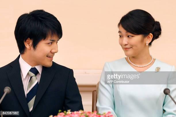 Princess Mako the eldest daughter of Prince Akishino and Princess Kiko and her fiancee Kei Komuro smile during a press conference to announce their...
