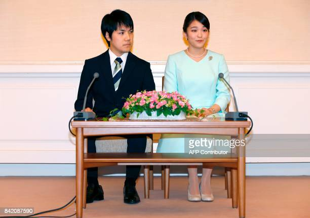 Princess Mako the eldest daughter of Prince Akishino and Princess Kiko and her fiancee Kei Komuro take part in a press conference to announce their...