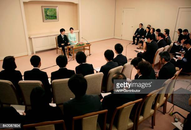 Princess Mako the eldest daughter of Prince Akishino and Princess Kiko speaks to the media with her fiancee Kei Komuro during a press conference to...