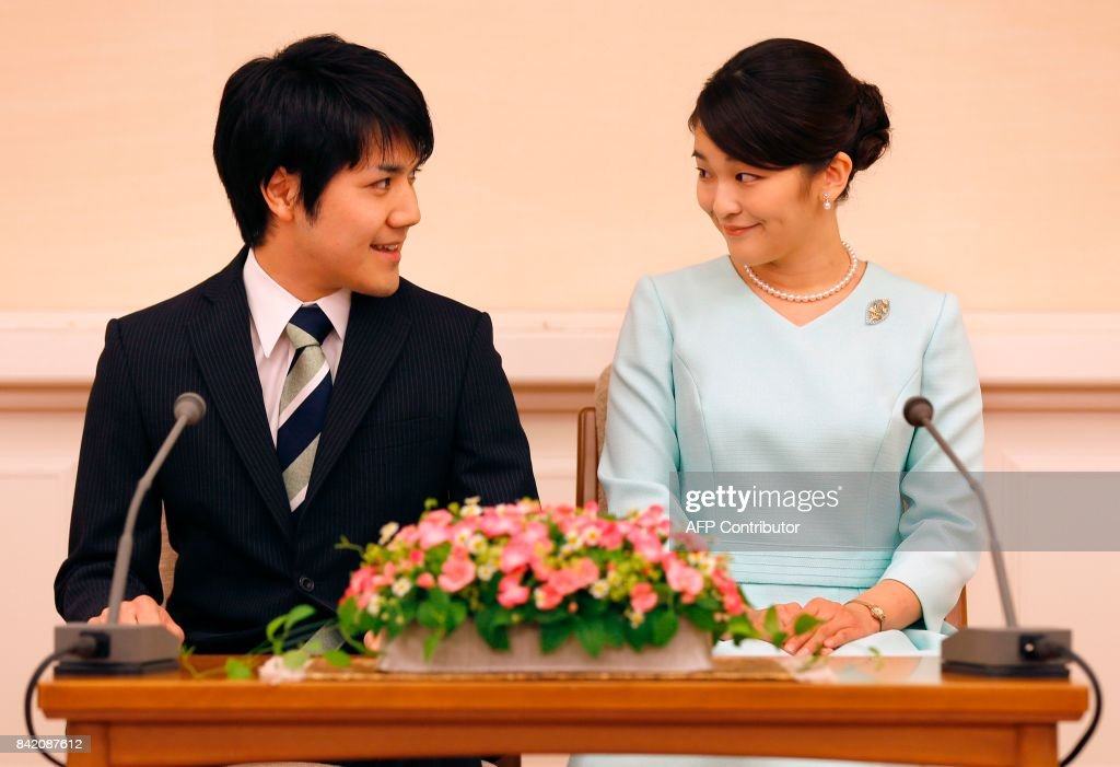 Princess Mako (R), the eldest daughter of Prince Akishino and Princess Kiko, and her fiancee Kei Komuro (L), smile during a press conference to announce their engagement at the Akasaka East Residence in Tokyo on September 3, 2017. Emperor Akihito's eldest granddaughter Princess Mako and her fiancé -- a commoner -- announced their engagement on September 3, which will cost the princess her royal status in a move that highlights the male-dominated nature of Japan's monarchy. PHOTO / POOL / Shizuo Kambayashi
