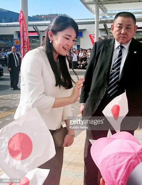Princess Mako the eldest granddaughter of Emperor Akihito waves to kindergarten children upon her arrival at JR Tajimi Station in Gifu Prefecture...