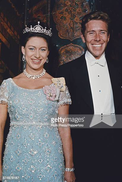 Princess Margaret Countess of Snowdon posed wearing a tiara with her husband Antony ArmstrongJones 1st Earl of Snowdon at a ball in Washington DC...