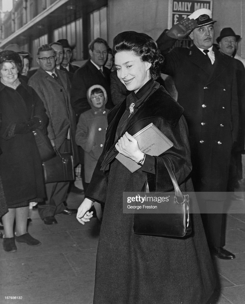 Princess Margaret, Countess of Snowdon (1930 - 2002) receives a salute from a commissionaire as she leaves the Ideal Home Exhibition at Olympia exhibition centre in London, 10th March 1964. The Princess is expecting her second child, Lady Sarah Armstrong-Jones, in May.