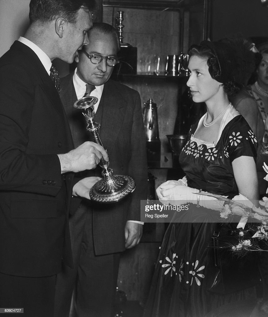 Princess Margaret opens the 13th Antique Dealers' Fair and Exhibition at Grosvenor House in London 10th June 1953 Here she is shown a George III...