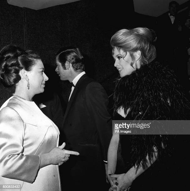 Princess Margaret talking in French with actress Brigitte Bardot at the Royal charity premiere of the film 'Shalako' at Leicester Square Theatre