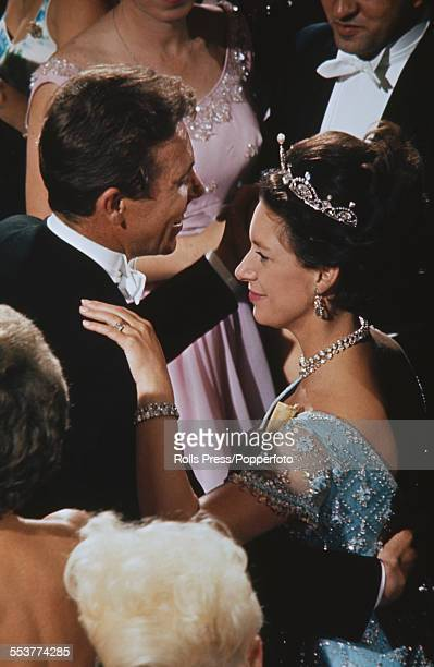 Princess Margaret wearing a tiara dances with her husband Antony ArmstrongJones 1st Earl of Snowdon at a ball in Washington DC in November 1965