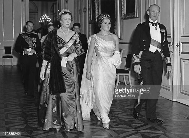 Princess Margaretha of Sweden and Prince Axel of Denmark accompany Princess Irene of the Netherlands at a banquet given by the Belgian government at...