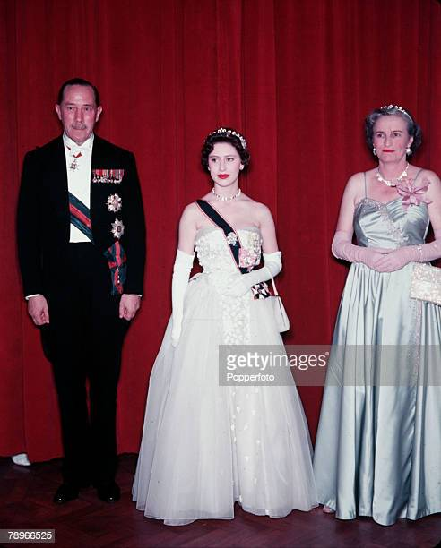 1955 Princess Margaret's Caribbean Tour Princess Margaret is pictured with Sir Hubert and Lady Rance at a State Banquet held in Government House Port...