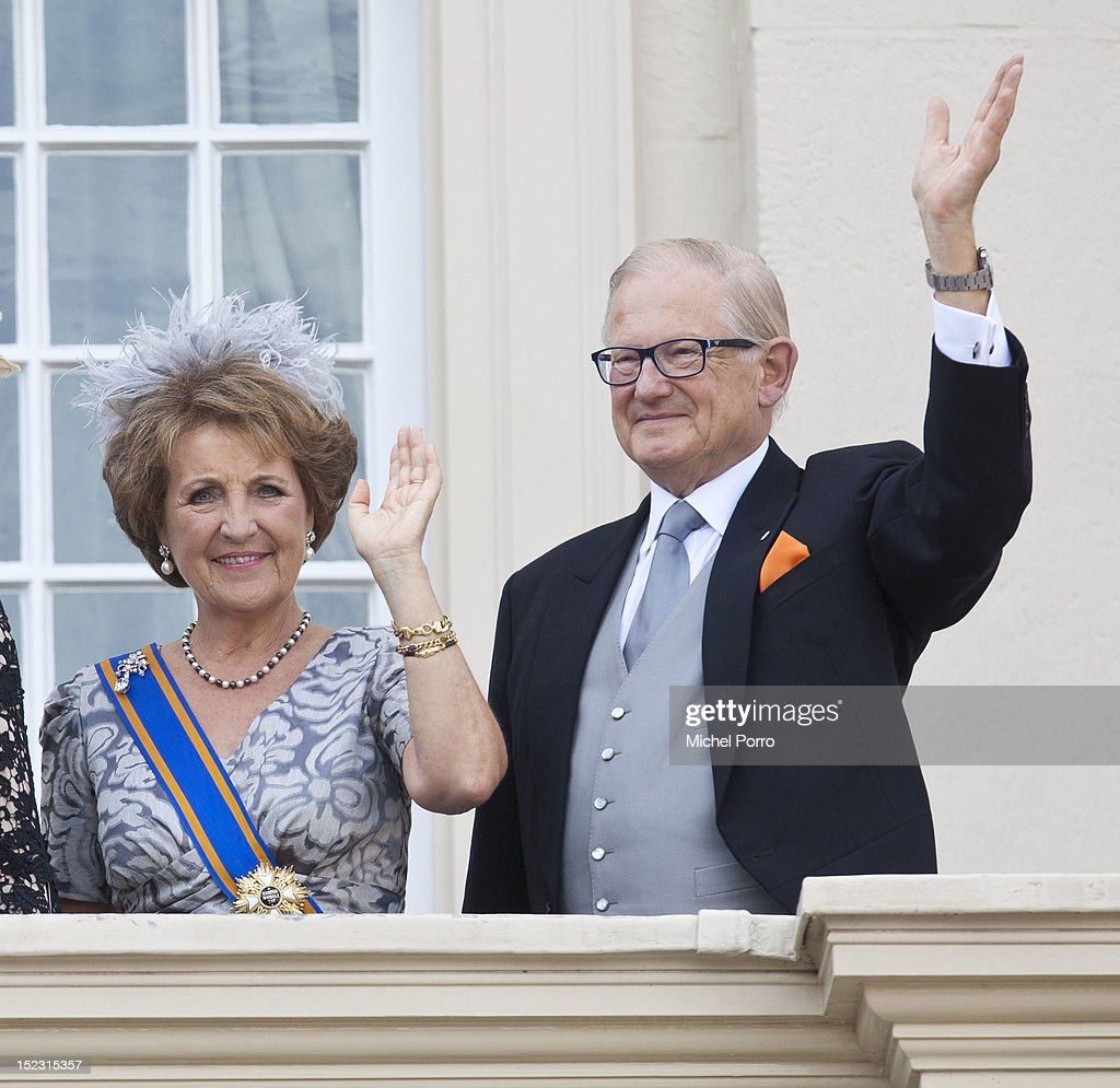 Princess Margriet of the Netherlands and Pieter van Vollenhove wave from the Noordeinde Palace balcony after attending Budget Day announcement on September 18, 2012 in The Hague, Netherlands.