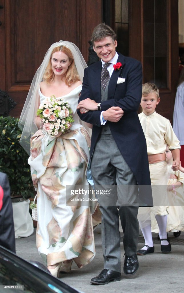 Princess Maria Theresia von Thurn und Taxis and her husband Hugo Wilson attend the wedding of Maria Theresia Princess von Thurn und Taxis and Hugo Wilson at St. Joseph Church in Tutzing on September 13, 2014 in Tutzing, Germany.