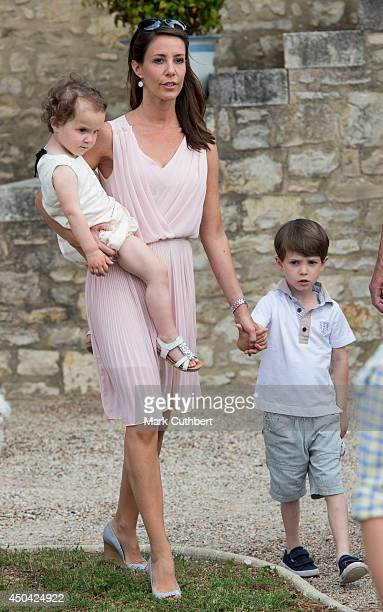 Princess Marie of Denmark with Princess Athena of Denmark and Prince Henrik of Denmark attending a Photocall at Chateau de Cayx on June 11 2014 in...