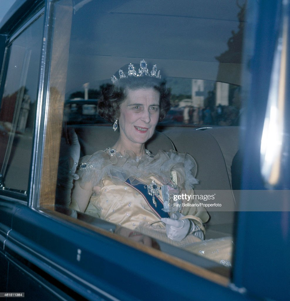 Princess Marina, the Dowager Duchess of Kent, arriving for dinner at Buckingham Palace in London on 10th July 1962. This image is one of a series taken by Ray Bellisario who was credited with being the 'original paparazzo' and someone who frequently upset the Royal Family with his informal and often unwelcome style of photography.