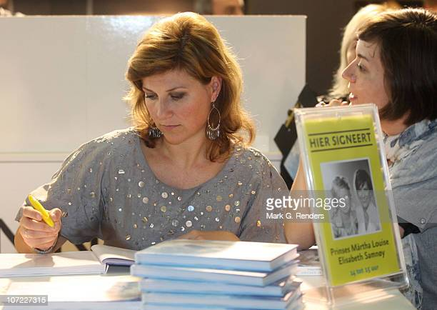 Princess Martha Louise of Norway signs her new book 'Discover Your Guardian Angel' at the Antwerp Book Fair on November 6 2010 in Antwerpen Belgium