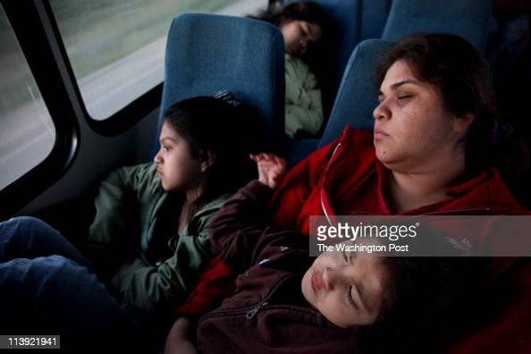Princess Martinez right sleeps on the 40minute bus ride from the USMexico border to Port Isabel Tx where she works at the local grocery store and her...
